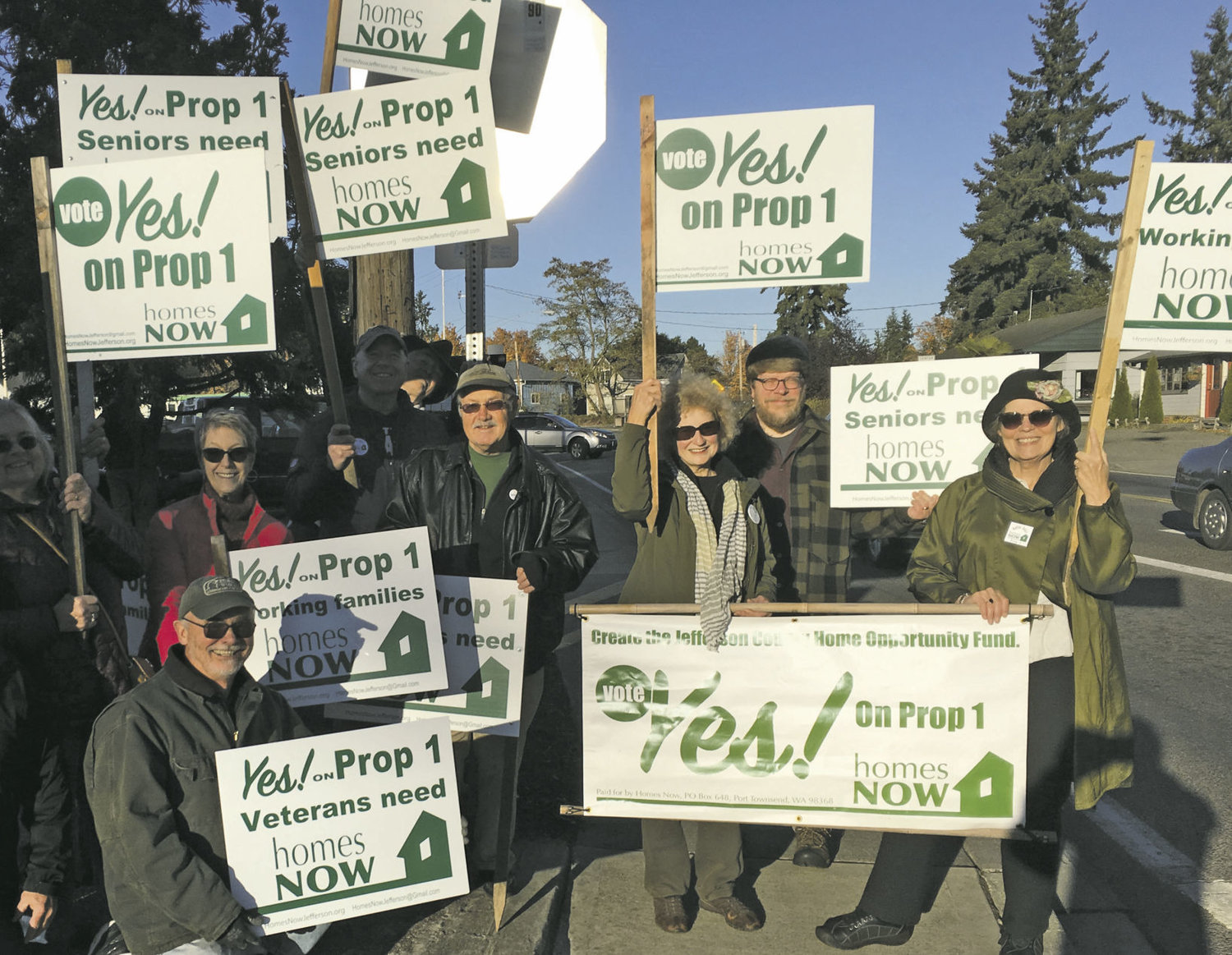 Supporters of Proposition 1 pose for a photo in Port Townsend. Smaller groups of supporters have assembled in Port Hadlock, according to Homes Now spokesperson Bruce Cowan. Courtesy photo Bruce Cowan
