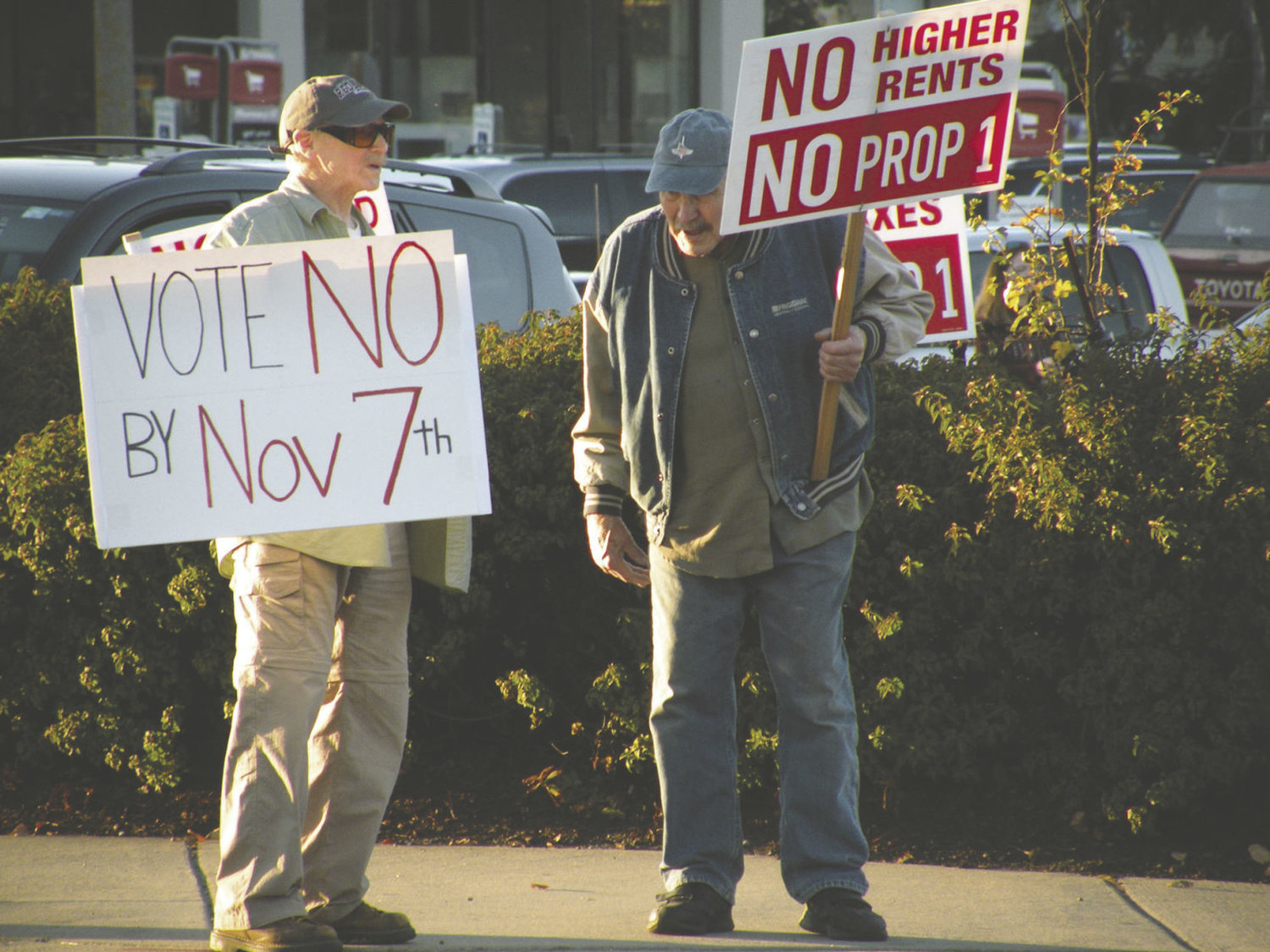 Two opponents of Proposition 1 stand on a corner of Sims Way Friday, Oct. 27. Larger groups of opponents have demonstrated on other days in Port Townsend.Photo by Allison Arthur