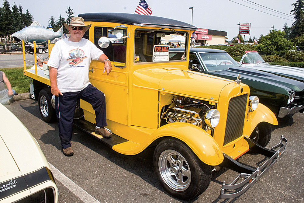 Port Angeles' Ed Fisher stands with his 1927 Graham beer truck, which he's selling for $29,500.