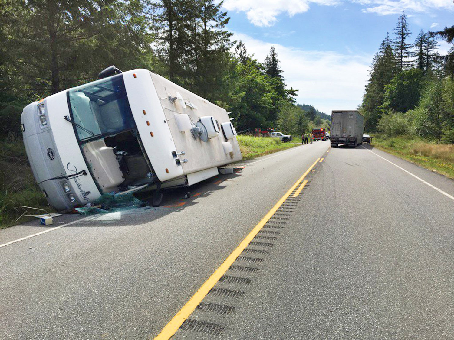 The driver of this Tradewinds RV made evasive maneuvers Aug. 15 after a tractor trailer hauling a livestock trailer south on U.S. Highway 101, initially failing to see a sedan slowing ahead, braked and steered into the northbound lane. That forced the RV driver to take action to avoid collision, which caused the RV to roll over on its driver's side, according to the Washington State Patrol. Photo courtesy East Jefferson Fire Rescue
