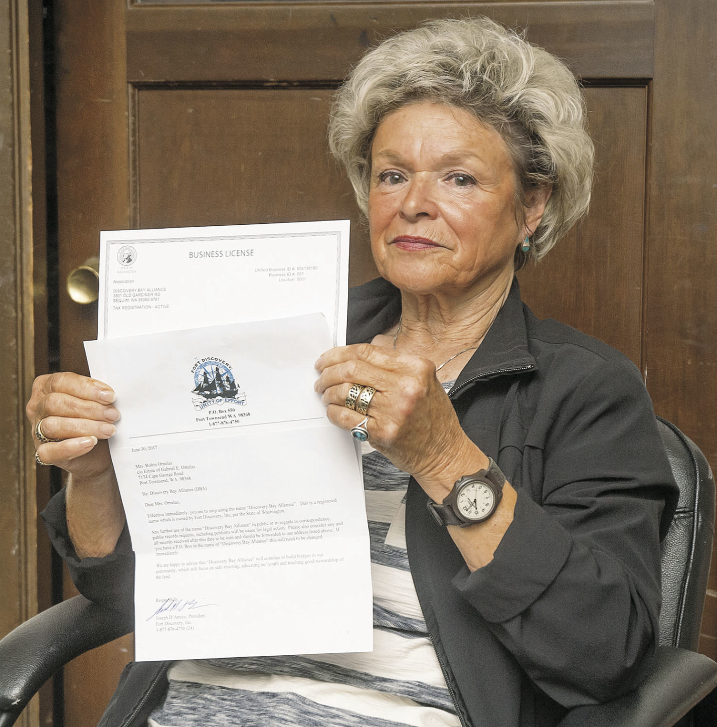 Robin Ornelas holds a copy of the letter that Joe D'Amico handed to her July 10 telling her to stop using the name Discovery Bay Alliance. That name has been used since 2005 by a group petitioning Jefferson County to take action on D'Amico's business for what the group deems is action by the business that runs contrary to a decision by a hearings examiner on land use. Photo by Chris Tucker