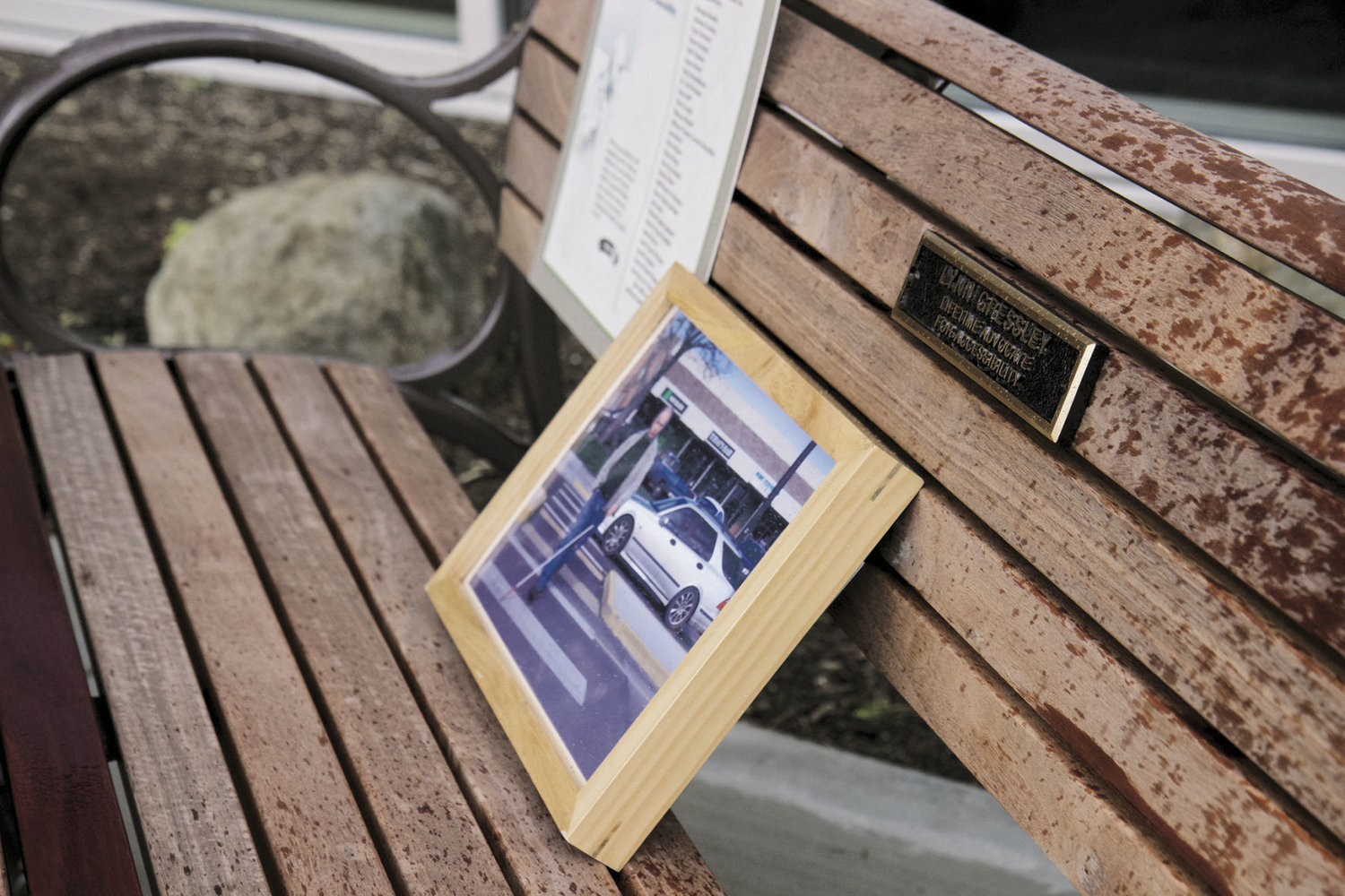 A photo of Lynn Gressley walking across a street in Port Townsend was placed on a bench in his memory. The bench is now in front of Jefferson Healthcare's Emergency and Specialty Services Building. Photos by Allison Arthur