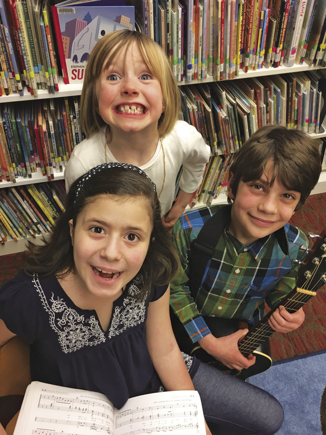 Port Townsend Children's Library Choir is back for another year under the direction of Phina Pipia. Rehearsals start Feb. 27. Pictured are Dare Bailey, Lila Morgan (center, top) and Tristan Erickson. Photo courtesy of Phina Pipia