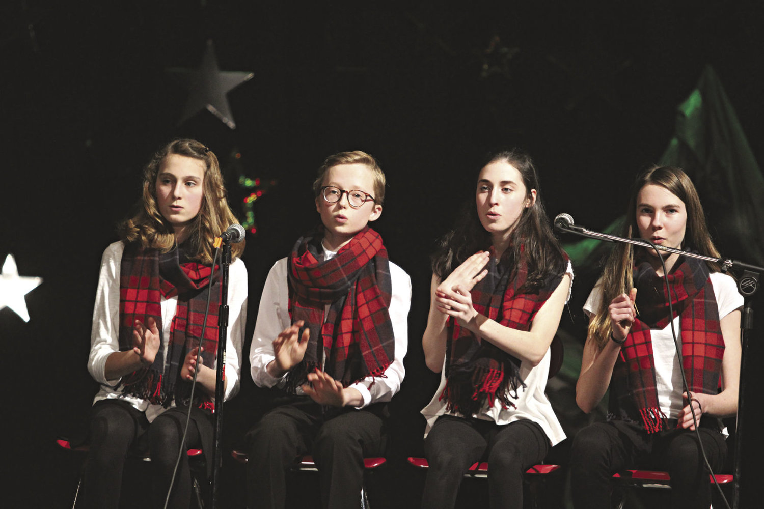 The Sharp Flats, composed of (from left) Maya Dow, Max Miles, Morgan Trail and Grace Wentzel, won third place in the junior division. The group is also to perform at Concerts on the Dock. Photo by Allison Arthur