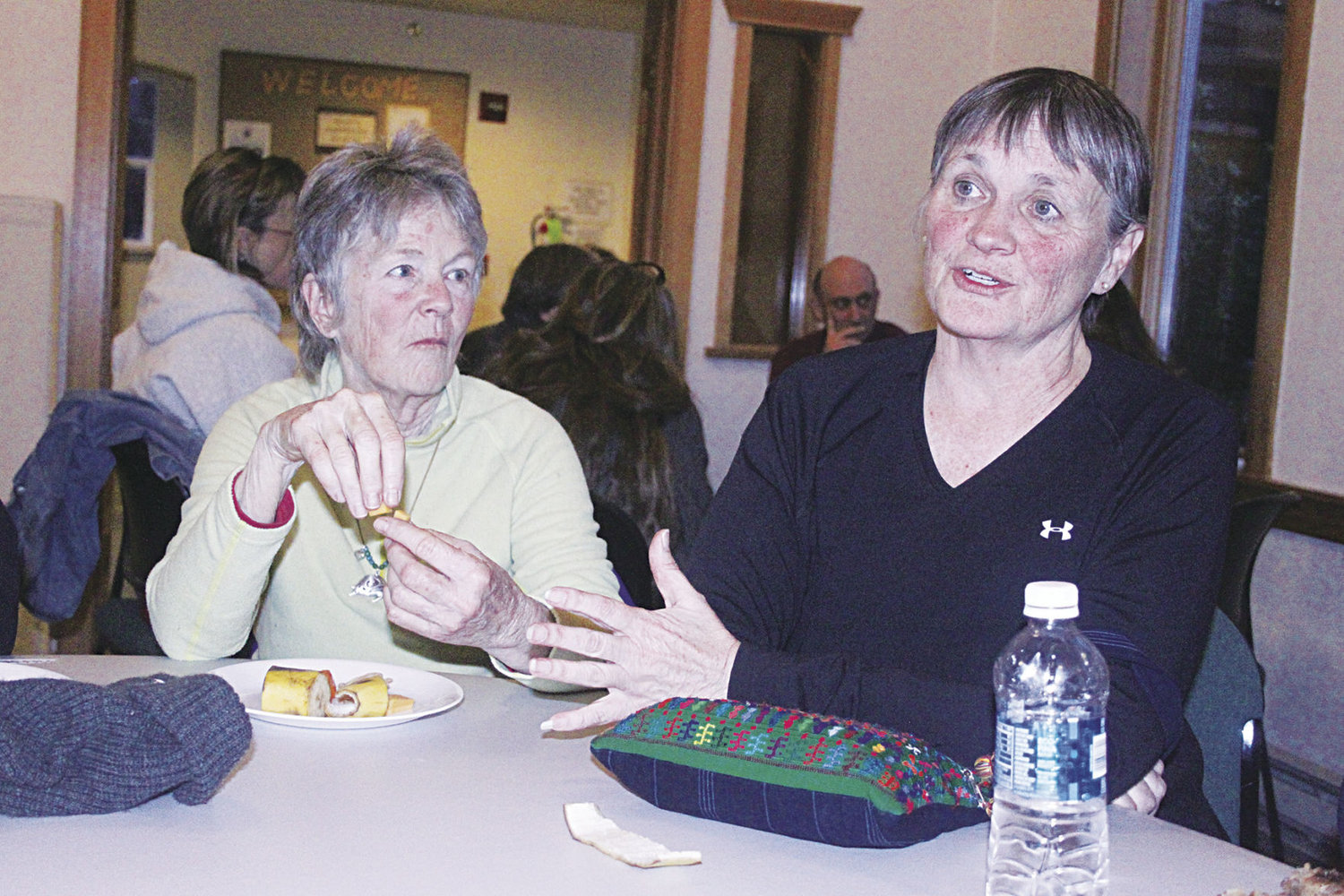 "Elisabet Skyhawk (left) and Katie Franco share their insights during the Quimper Unitarian Universalist Fellowship's public conversation on what it means to be a ""sanctuary community"" Feb. 20. Photo by Kirk Boxleitner"