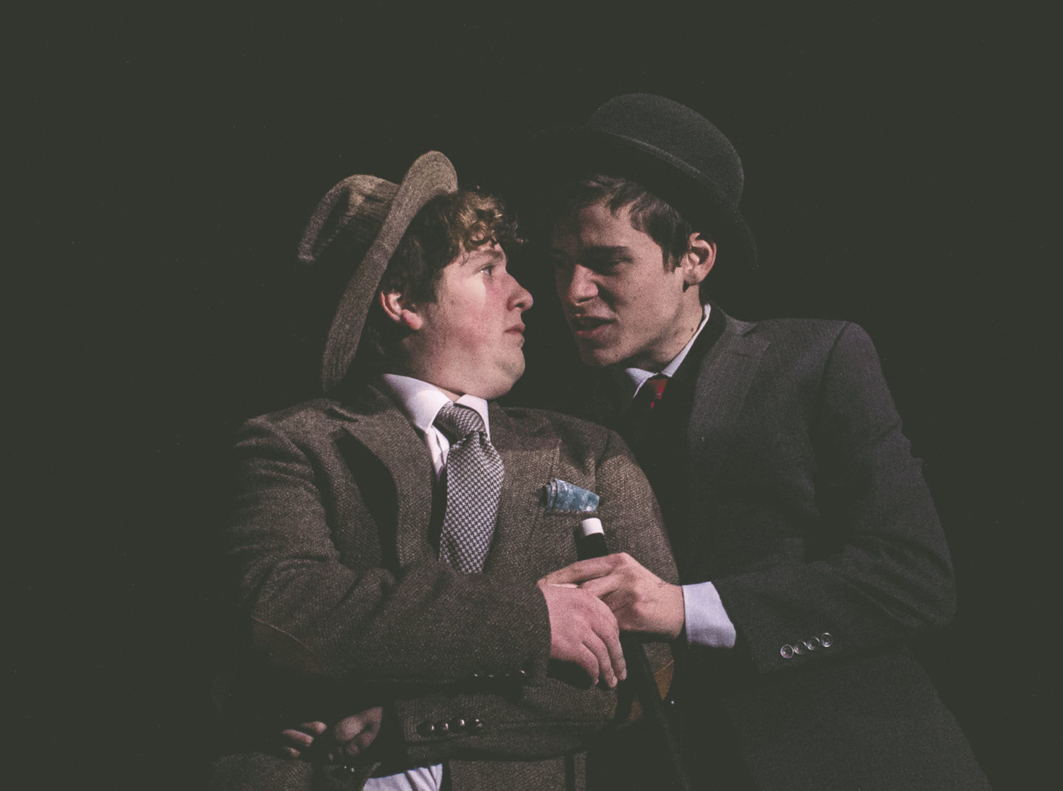 "William McGonagall (Austin Krieg, left) receives a warning message from the would-be assassin of Queen Victoria, Roderick McLean (Rowan Gallagher) in ""The Disaster in Verse,"" which opens Friday at Port Townsend High School. Photo courtesy Richard Alan Sloane"