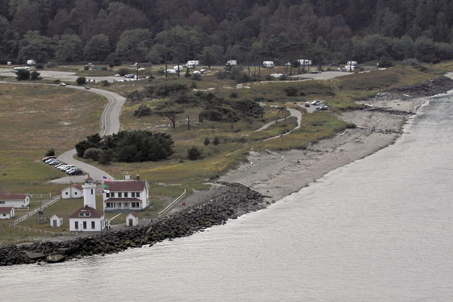 This 2010 view of Point Wilson shows how the rock riprap, added to the point in 2005, has changed; a beach dune has been worn down and has a trail going over it, but it's still mostly intact. 2010 Leader file photo by Patrick Sullivan