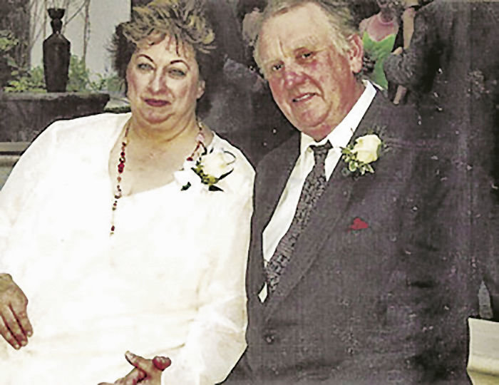 Janice and Patrick Yarr, pictured at a family wedding, were murdered in their home on March 18, 2009. An estimated 700 people attended their memorial service. Courtesy photo