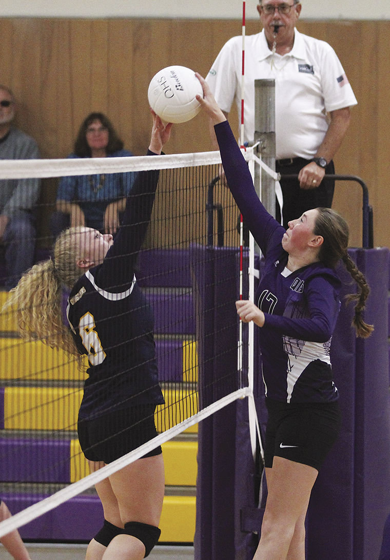 Quilcene senior Bailey Kieffer (right) blocks a hit attempt during the Lady Rangers' league-opening win Sept. 9 against visiting Tacoma Baptist. Photo by Patrick Sullivan