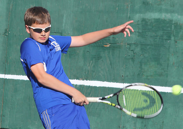 Chimacum sophomore Zach Engle warms up for a tennis match. Photo by Patrick Sullivan