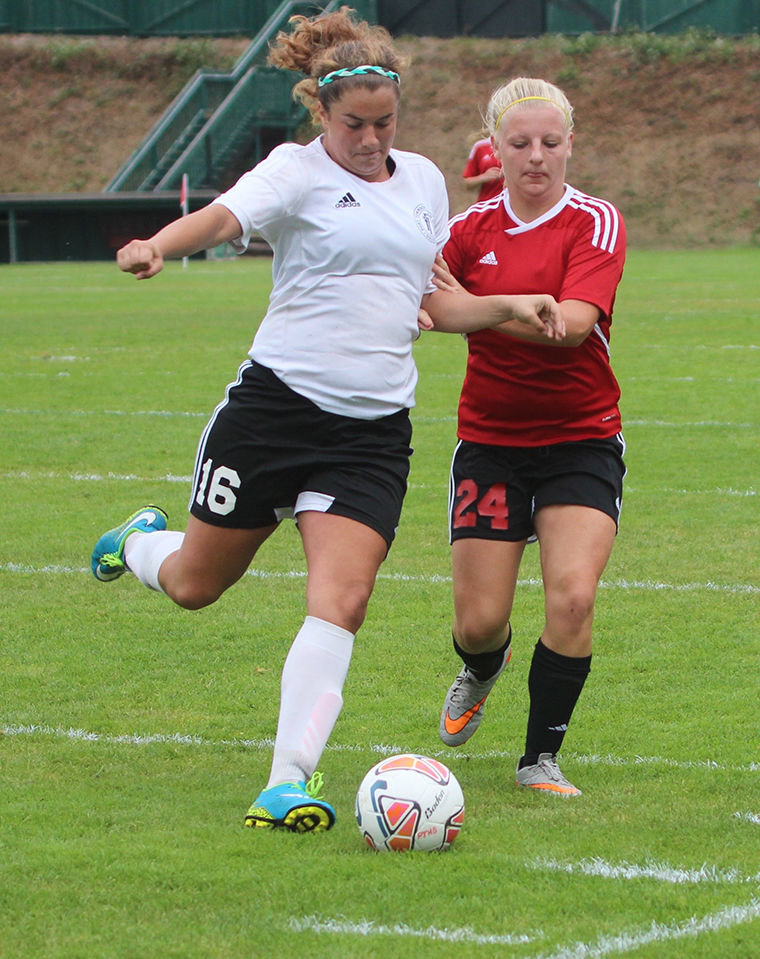 Port Townsend sophomore Breanna Franklin (left) goes for the ball Sept. 17 in a 3-0 league loss to Coupeville. Photo by Stephanie Davey