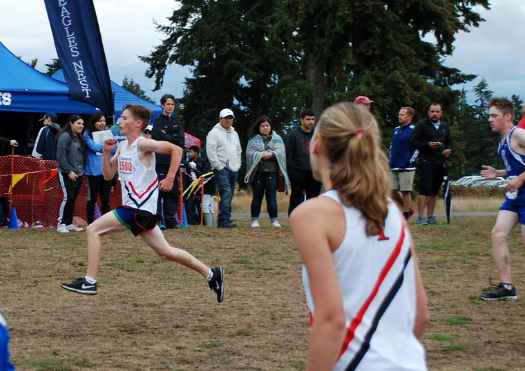 Port Townsend High School freshman Reece Kjeldgaard races toward the finished, cheered on by senior Ari Winter. Photo courtesy Janeen Armstrong