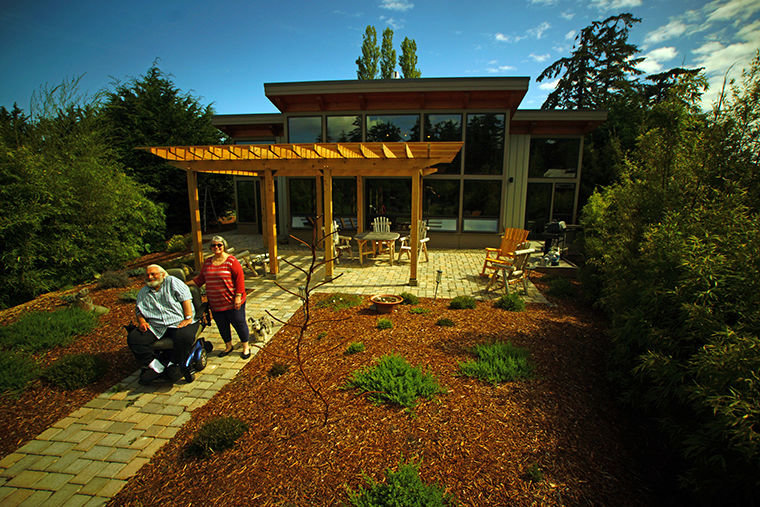 Dave and Judi Cornif love their home in Port Townsend's Corona Gardens, built and customized from a home kit by FabCab of Seattle. The house is one of four to win a U.S. Department of Housing and Urban Development award; the particular award conferred to the PT house honors a project that improves housing accessibility for people with disabilities. Photo by Nicholas Johnson