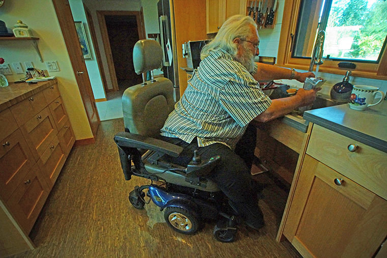 Dave Cornif, who has spent most of his time in a wheelchair since 2012 due to hip and other health issues, loves his new home's kitchen. In his power scooter, he can use the sink and the microwave, which is in a drawer, not an upper cabinet. Photo by Nicholas Johnson