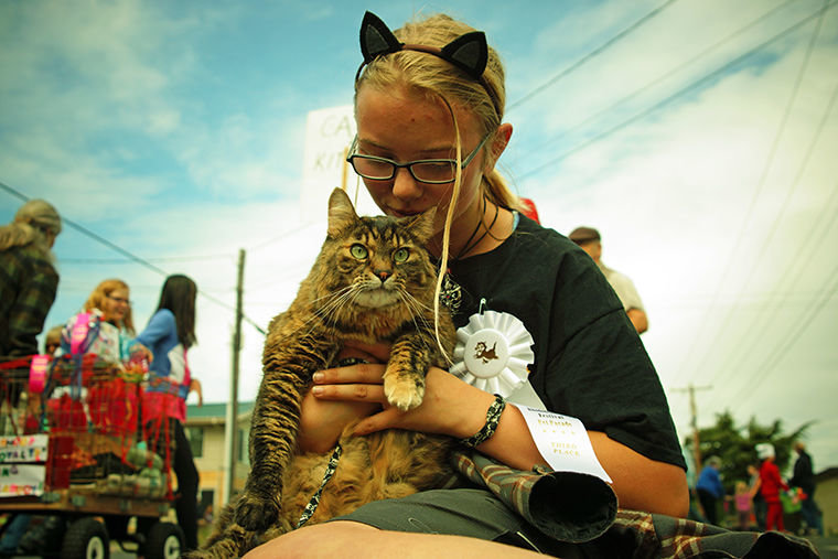 Isabella Wardleigh, 13, holds her torbie cat Darla May before the start of the Rhododendron Festival Pet Parade May 19.