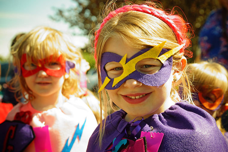 Leighton Dunn (right), 5, and Gwen Mathews, 5, of Littlefoot Preschool in Port Hadlock stand ready to save the day ahead of the Rhododendron Festival Kiddies Parade. Photo by Nicholas Johnson