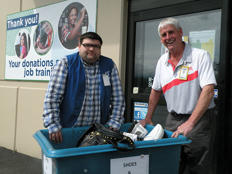 Kevin Roberts of Chimacum is hoping to land a job at Goodwill in Port Hadlock and is volunteering first to learn the ropes. Manager Dave Shaub says the Port Townsend shop has a staff of 19 people, six of whom have come through a community jobs program. Photo by Allison Arthur