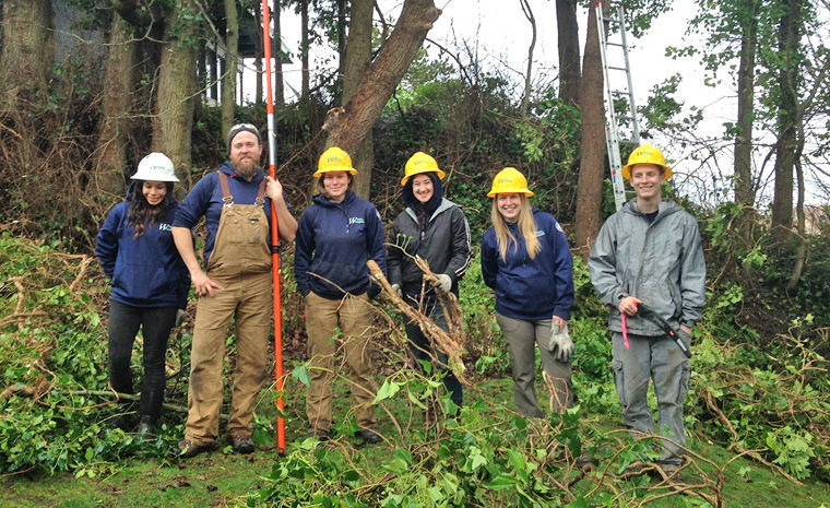A Puget SoundCorps work crew at the top of Terrace Steps is on a break from taking down ivy from the park trees above Haller Fountain in 2015. Pictured (from left) are Port Townsend local Gabby Andrews, crew leader John Longsworth, Bonnie Reed, Selene Convy, Lauren Kemper and Jessey Watters. Submitted photo