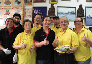 1-2-3 Thai Food employees (from left) Manne Kaylor, Alex Picard, Jenny Chenruk, owner Eddie Chenruk, Charlie Chenruk, Pitt S., Chuck Chenruk and Christa Hall take a moment from a busy day at the popular thai restaurant. The business is run by the Chenruk family and they say they feel their customers are part of that large extended family. Photo by Allison Arthur