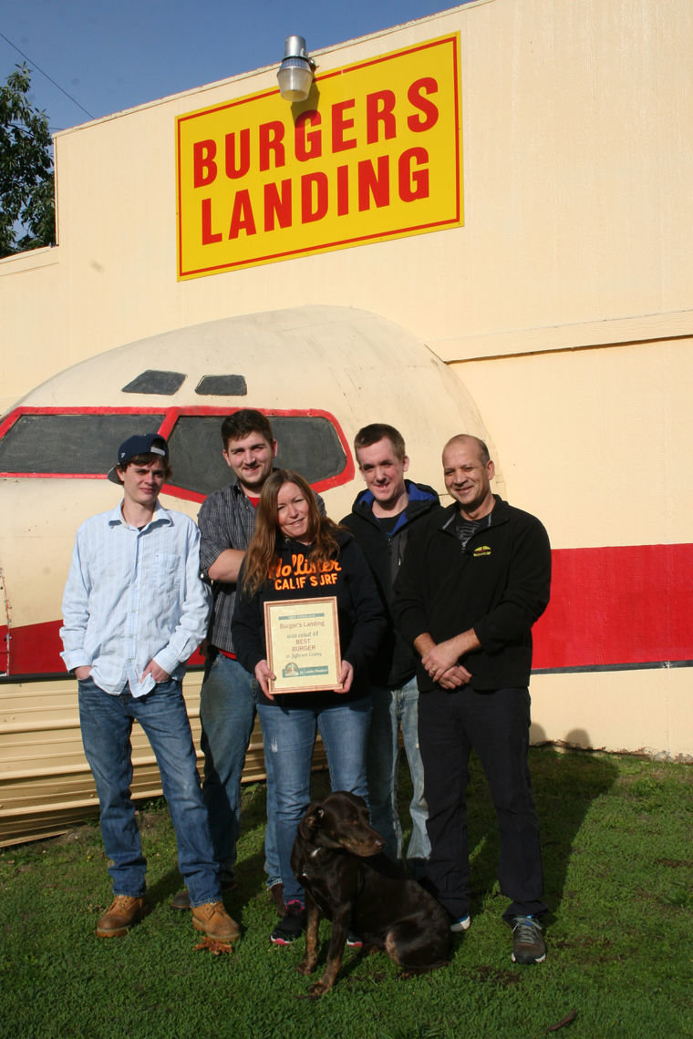 "Burgers Landing owner Randy Lechtenberg (far right) stands outside his restaurant with employees (from left) Seth Mitton, Nick Jones, Barb Gillespie, Eric Mousseau and dog Samarah. Other staff not pictured include Vanessa Stone, Ashley Lashua, Traycn Anderson, Heidi Taylor and Paulette. ""Thank you to all of our loyal customers,"" Lechtenberg said. ""We buy quality ingredients, have a great crew and you!"" Photo by Jen Clark"
