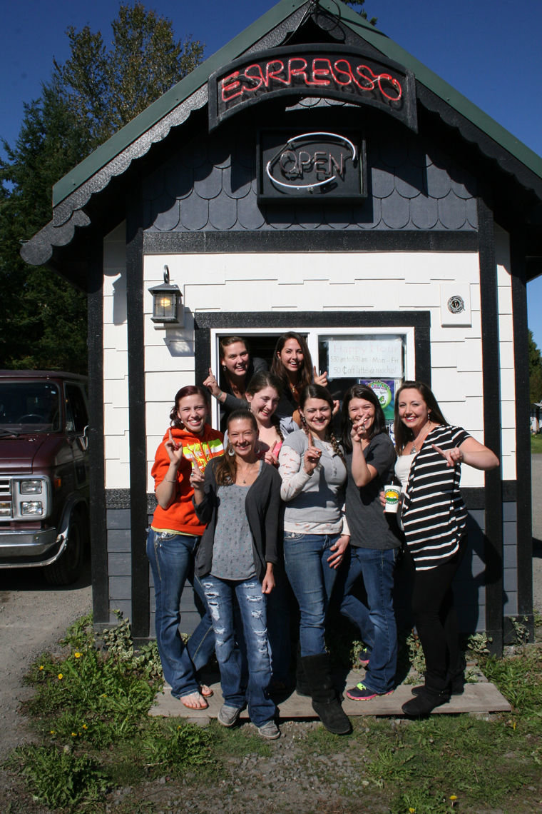 Easy Times Espresso employees (from left, in window) Josie Markwick, Jennifer Fountain, (in front) Holly Chute, Jennifer Lyons, Angela Knutson, Dezi Rose, Nikki Ellis and Jamie Montgomery gather outside their stand in Port Hadlock. Photo by Jen Clark