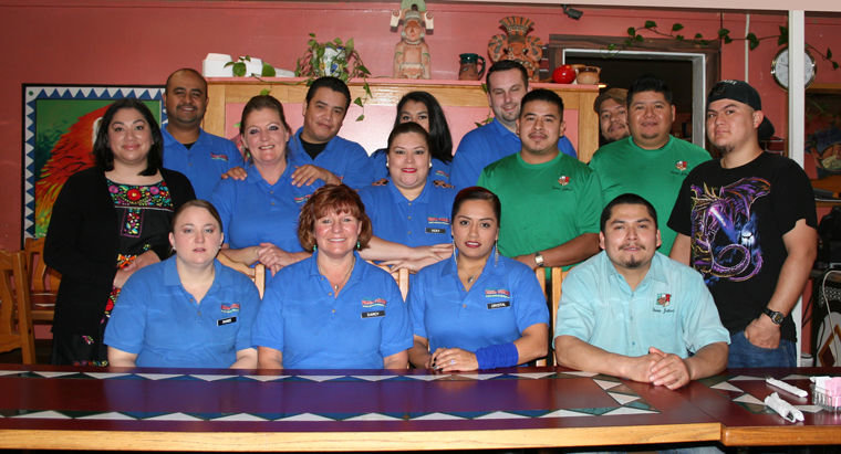 Fiesta Jalisco employees (back to front, from left) Jose, manager Cesar, Aaliyah, Jarred, Core, owner Elena, Michelle, Vicky, Alex, Raul, Tarsis, Ranee, Darcy, Crystal, Oscar (Head Chef) gather inside the popular Port Hadlock family Mexican restaurant. Photo by Jen Clark