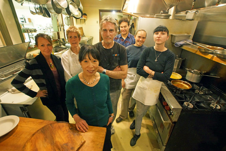 Hillbottom Pie owners Mariko Willenhag and Tim Roth, center, are surrounded by (from left) Michele Mailloux-Zabransky, Julie Lee, Nick Alexander, Cristi Christensen and Sadie Maher in the kitchen of their downtown Port Townsend restaurant. Photo by Nicholas Johnson