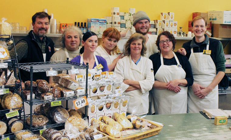 Port Townsend Food Co-op food services employees (from left) Brendan Johnson, Nicholas D'Andrea, Angela Mason, Estelle Giangrosso, Tracy Nichols, Josh Madill, Jo Holmstedt and Dylan Carter gather behind the grocery store's deli counter. Combined, they represent over 51 years of service to the Food Co-op and the Port Townsend community. Photo by Kathie Meyer