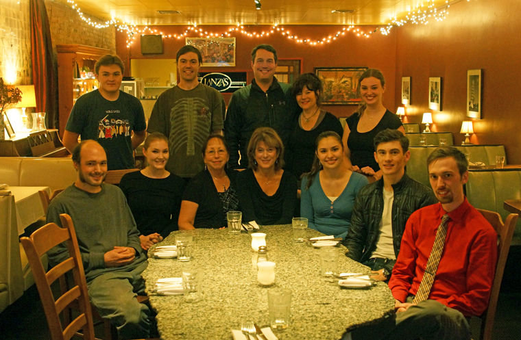 Lanza's Ristorante owners Steve and Lori Kraght (center back) are surrounded by employees, including (from left) Gannon Short, Seth Nelson and Danielle Lund in back, and Jimmy Pavlicek, Jaclynne Harrell, Norma Bridges, Julie Lanza, Rebecca Spencer, Milo Steimle and Cameron Meiner. Not pictured are Linda May and Brooklyn Johnson. Photo by Nicholas Johnson