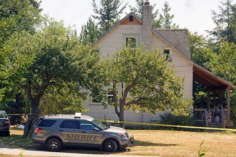 A Jefferson County Sheriff's vehicle sits parked at the side of a home along Swansonville Road west of Port Ludlow Thursday, July 23 following an alleged murder and attempted suicide. Photo by Nicholas Johnson