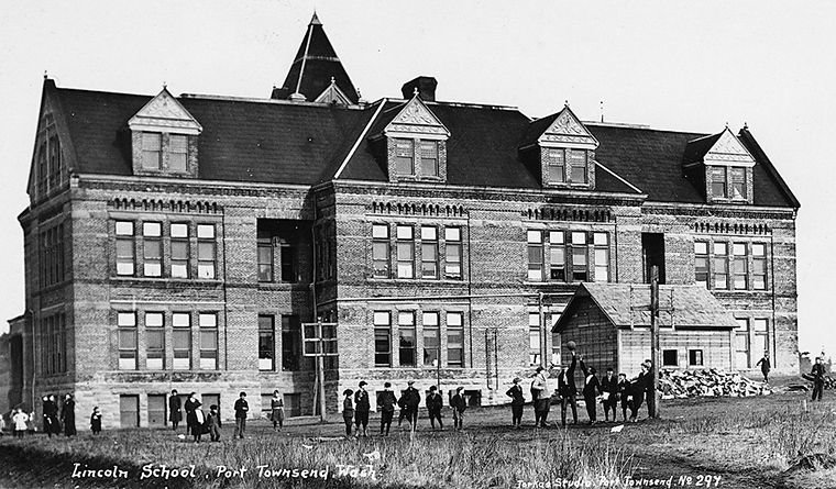 This is a seldom-seen view of the back of the Lincoln School. The school was first used in 1894. The structure's clock tower was lowered in 1899; its roofline was altered and top floor removed in about 1937. The building was last used by students in 1980, and the school district's administrative offices, subsequently housed there starting in 1992, were vacated in 2012. Jefferson County Historical Society Collection
