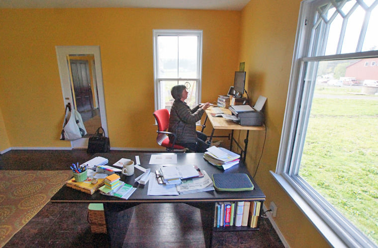 Heidi Eisenhour of the American Farmland Trust works in her new office in the FarmHouse Offices and CoLab at the historic Brown Dairy in Chimacum on April 30. Photo by Nicholas Johnson