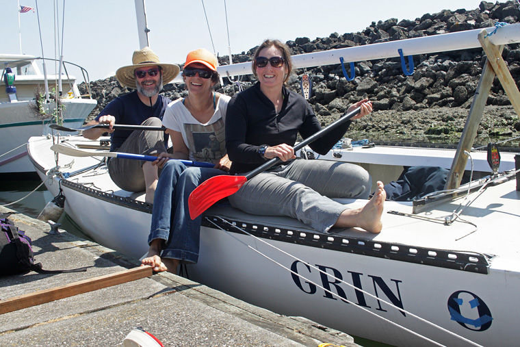 Team Grin members (from left) Jeremy Lucke, Hannah Viano and Jullie Jackson have fun while preparing their Etchells 22 for the Race to Alaska, which departs PT for Ketchikan on June 4. The Etchells 22 is named for its length at the waterline; the racing sailboat is 30 feet long overall and built for speed. Photo by Robin Dudley