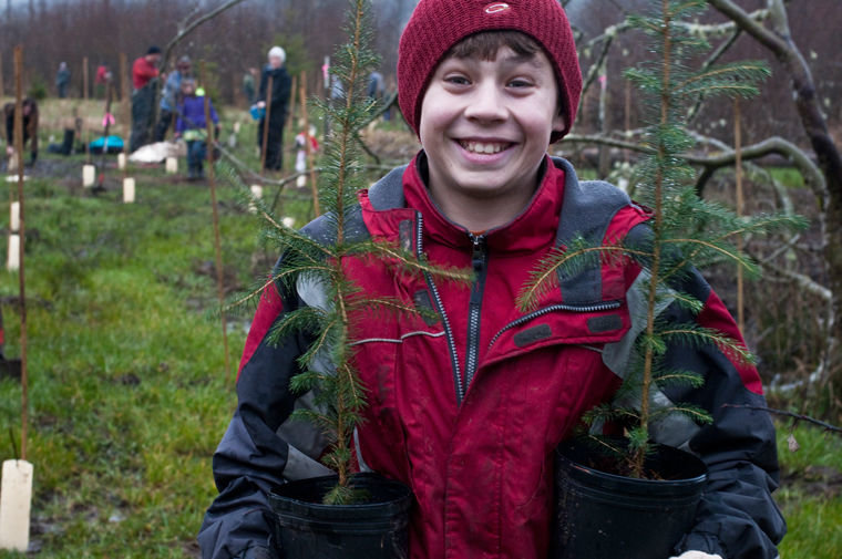 Many of the young people involved have participated in multiple plant-a-thons. Ari Pape Uphoff, now a Chimacum High School Pi Program student, is pictured at the event in 2011.