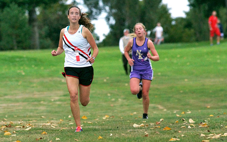 Redhawk senior Hannah Trailer won the home-opening cross country race hosted at the Port Townsend Golf Club Oct. 1. Community and parent volunteers help host another Olympic League meet at the golf course on Wednesday, Oct. 15. Photo by Nicholas Johnson