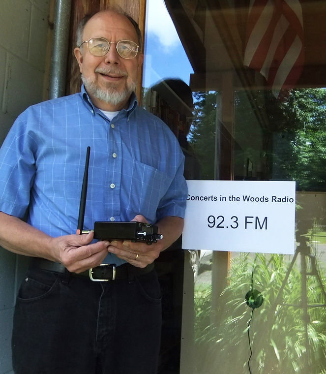 Norm Johnson holds the transmitting device for the Coyle Community Center's new low-power radio station, 92.3-FM . Submitted photo