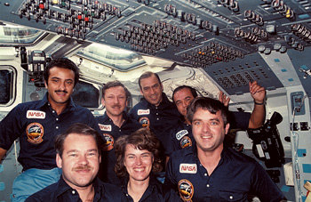 John Fabian is photographed with his crew in mid-June, 1985 aboard the Space Shuttle Discovery. The astronauts are, first row (from left) John Creighton, Shannon Lucid and Dan Brandenstein; second row, Saltan al-Saudi of Saudi Arabia, Steve Nagel, Fabian and Patrick Baudry of France. NASA photo