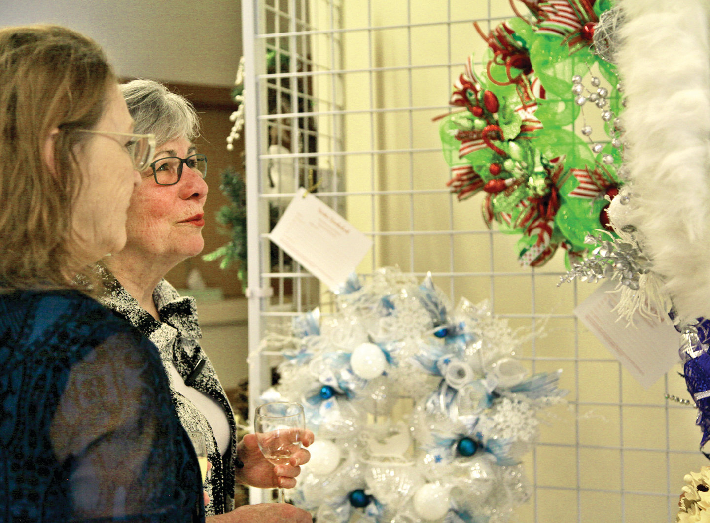 Attendees at the Festival of Wreaths look at decorations donated by area artists and businesses for sale at the event. Proceeds benefit the Jefferson Healthcare Foundation.