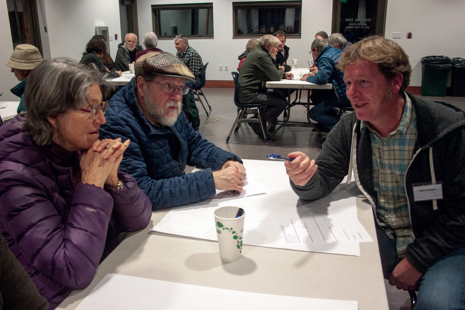 From left, Nancy Vilogran and Frank Poyle offer their input on what they're looking for in a city manager to Ned Herbert at the Cotton Building Nov. 28.