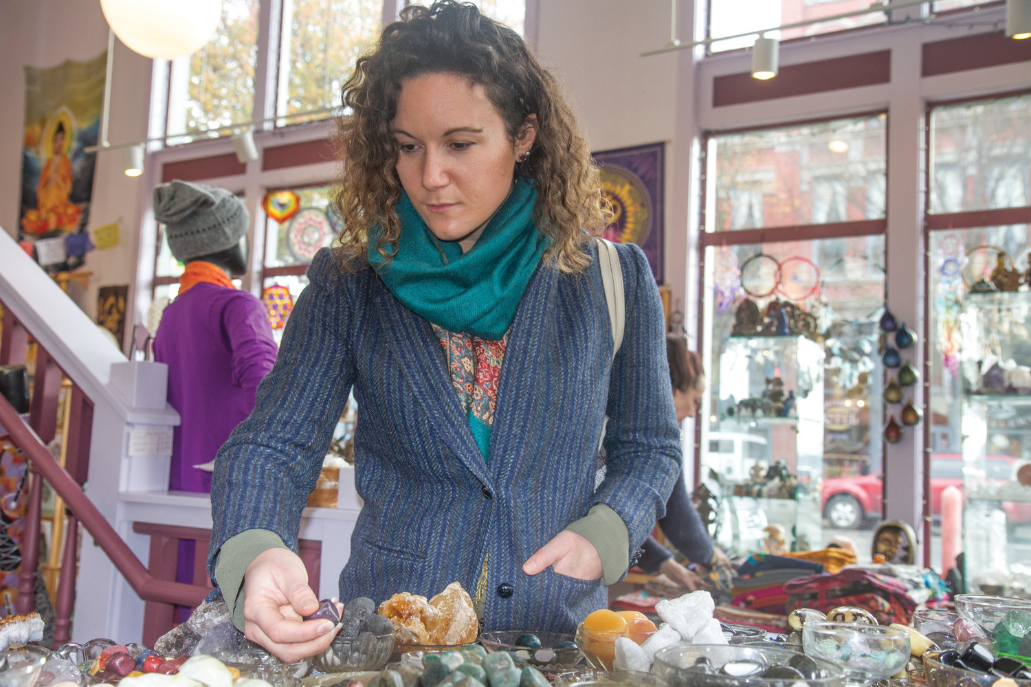 Lauren Anderson-Smith of Seattle picks through the stones offered at Phoenix Rising during a day trip to Port Townsend on Nov. 28.