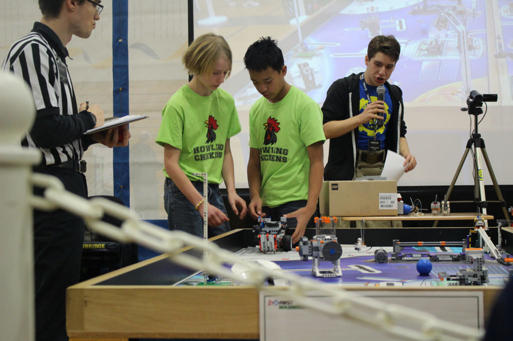 The Howling Chickens, the veteran team from the Port Townsend-based Northwest Discovery Lab, work on their robot Dec. 8 in the Olympic Peninsula regional qualifying event at Bainbridge Island High School.