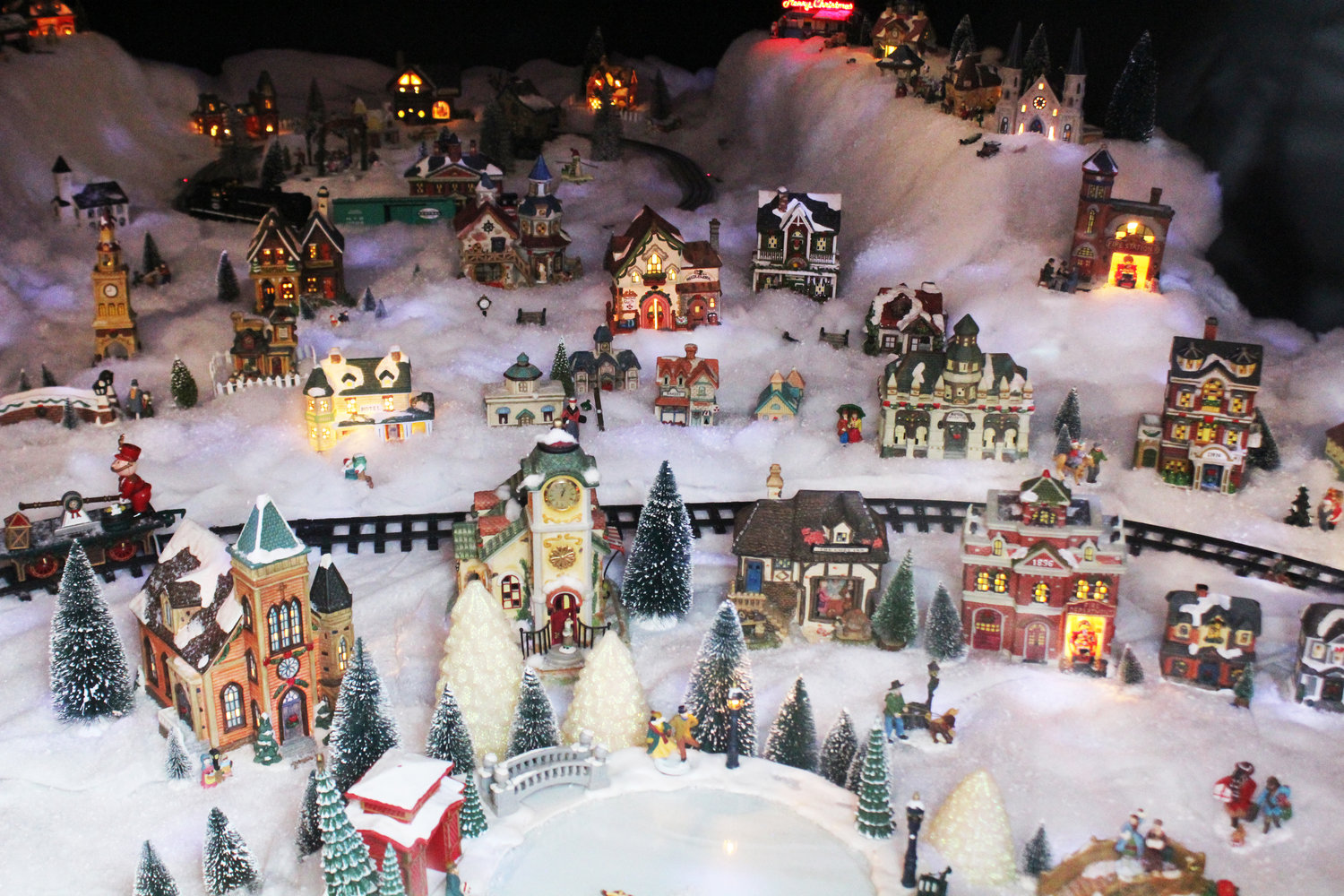 Christmas Villages.Miniature Village Lights Up Christmas Window Port Townsend