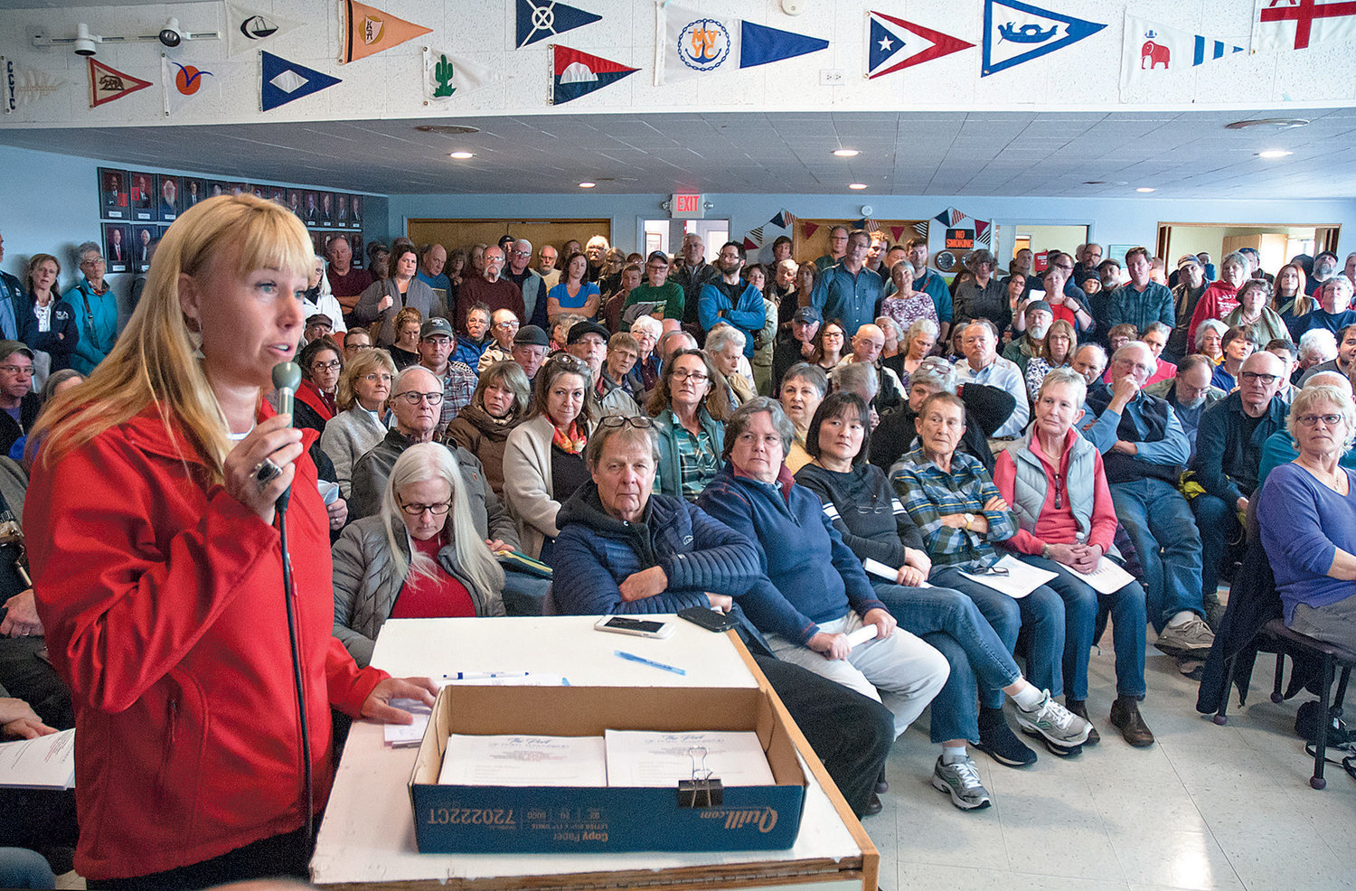 Kris Nelson speaks to Port of Port Townsend commissioners about the adverse impacts replacing the south jetty at Point Hudson would have to downtown businesses during a special meeting at the Port Townsend Yacht Club on March 20.