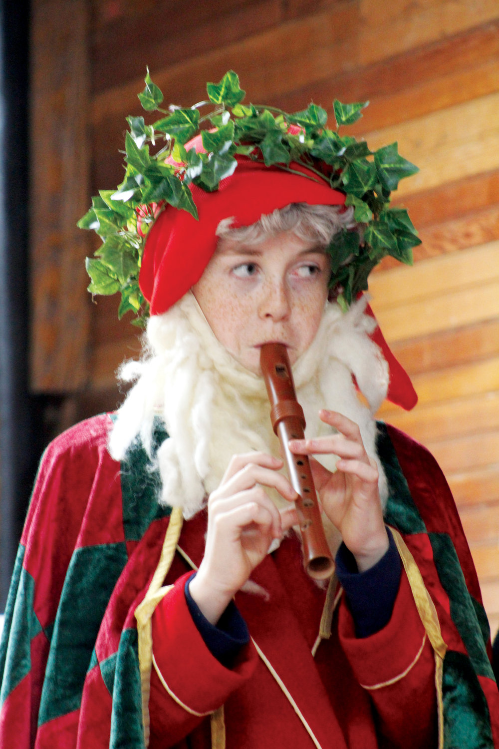 Father Christmas, played by Rowan Elliot, plays a traditional medieval piece on the recorder.