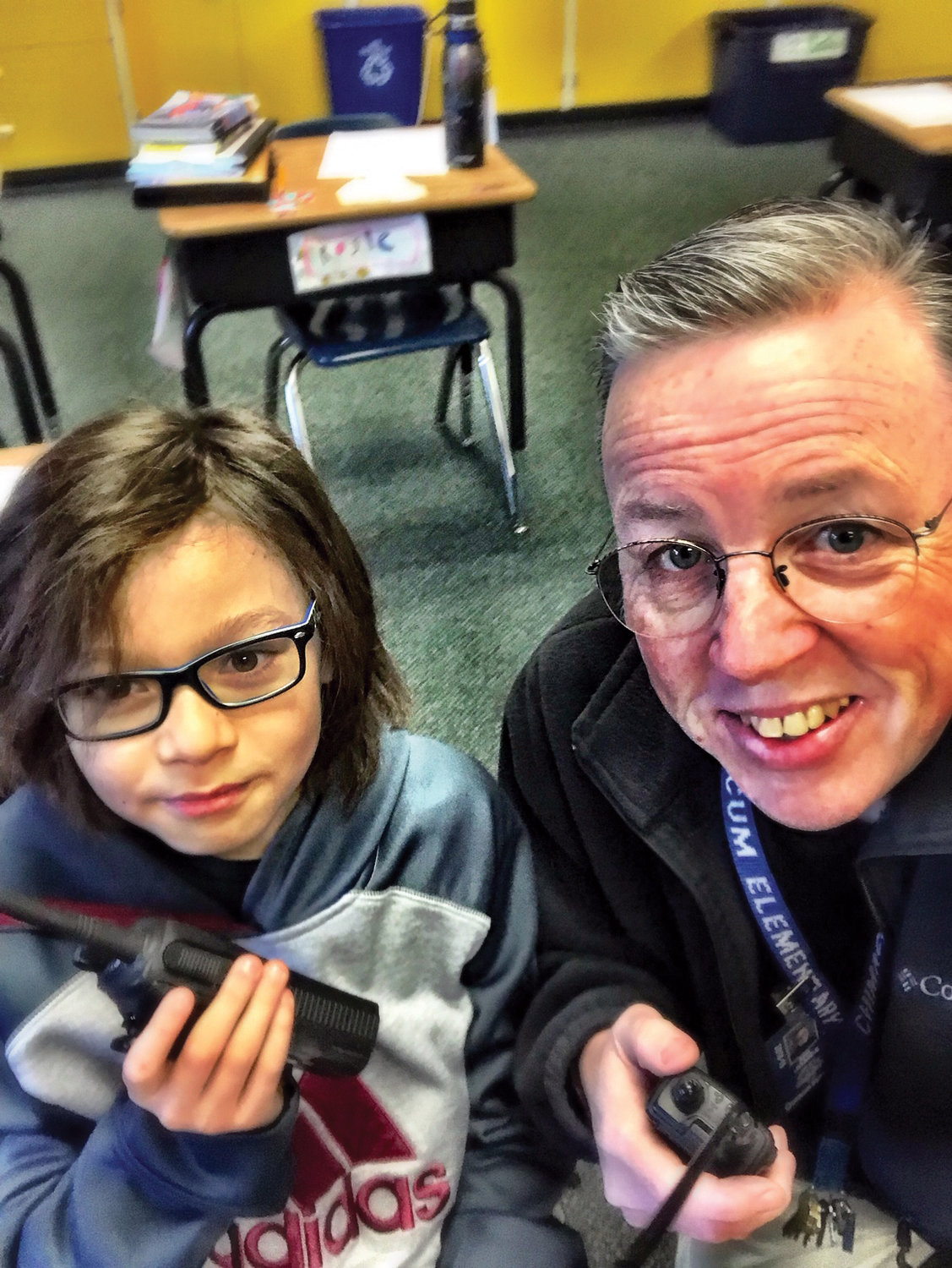 Chimacum Elementary fourth-grader Ronin Peralta is ready to pursue ham radio with Chimacum Elementary teacher James Betteley.