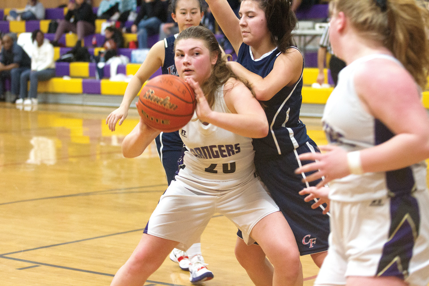 Quilcene junior forward Maddie Coffey looks to pass out of the post Jan. 30 during the Rangers' win over Christian Faith. Coffey powered through contact to complete four 3-point plays and kept Quilcene's postseason hopes alive.