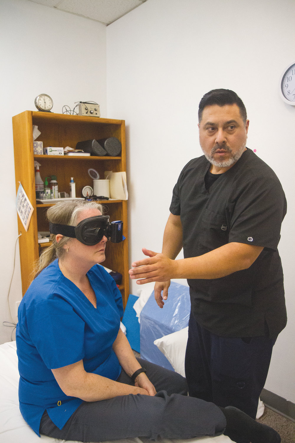 Barbara Arrowsmith, a physical therapist assistant at Apex Balance and Rehab, models the videonystagmography system, which she and physical therapist Chris Martinez can use to diagnose dizziness issues.