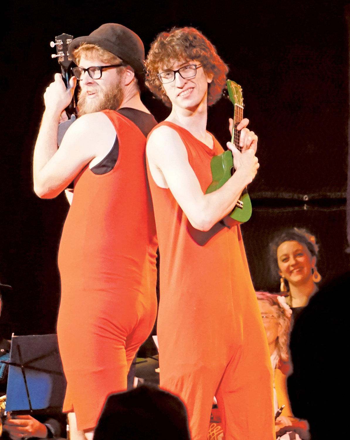 The juggling and musical duo, Strangely Jeremiah, perform with their ukuleles.