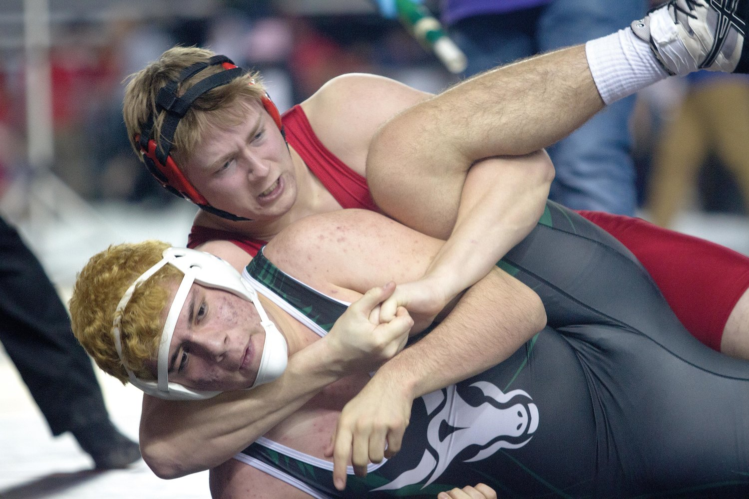 Port Townsend junior Wes Blue, in red, ties up Chelan sophomore Adrian Martinez in their first-round consolation bout. Blue won back-to-back loser-out matches before he ran into Colville senior Ryder Goff, who won six straight to place third.