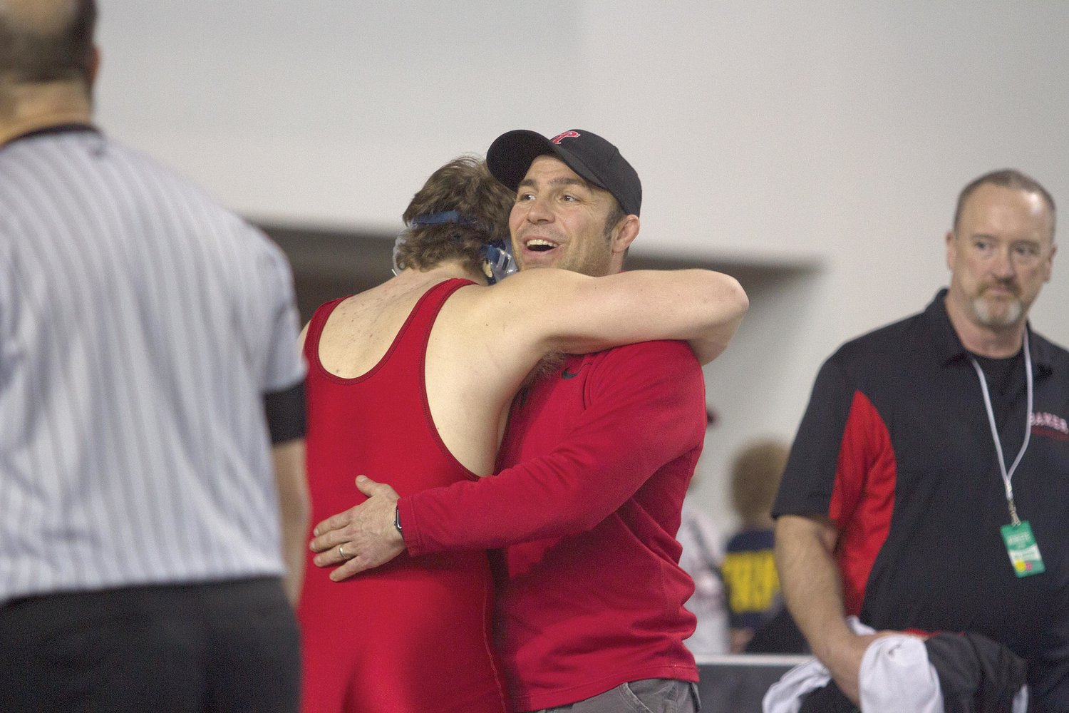 Redhawks coach Steve Grimm hugs Kyle Caldwell after the Chimacum sophomore secured a top-eight medal on Feb. 16.